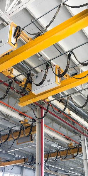 Overhead cranes inside industrial building. Bridge cranes inside hangar.